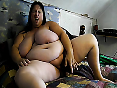 Obese brunette masturbating home alone