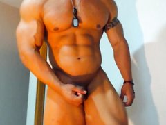 Muscle bodybuilder showing his perfect body in cam for admirers