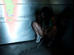 woman pissing in elevator