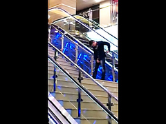 Wasted guy pissing in the mall
