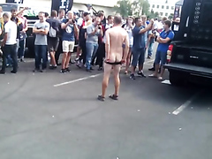 Guy dancing to the music naked