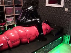EXTREME BONDAGE IN INFLATABLE RUBBER