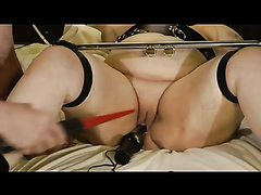 Submissive wife strapped in and toyed with