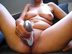 Chubby brunette masturbating with a big vibrator