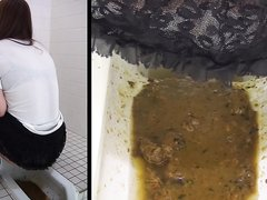 2 Japanese girls diarrhea in floor toilet.