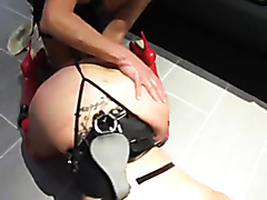 Dominant couple drilling their slave