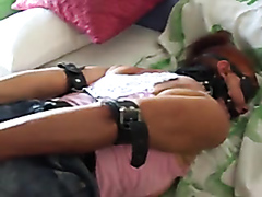 Helpless submissive girl with a dildo in the aas