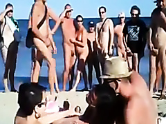 Amateurs in a group fuck at the nudist beach