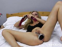 Speculum and long dildo deep in ass