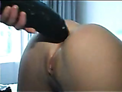 Hot babe drills her asshole with a massive dildo