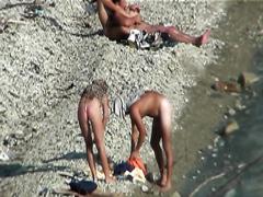 Horny couple caught having sex on the beach