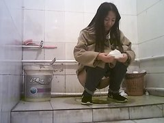 Chinese girls urinate in toilets - video 4