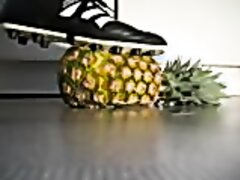 GUY STOMPING PINEAPPLE WITH HIS SOCCER SHOES