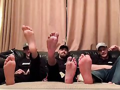 three lads showing off feet